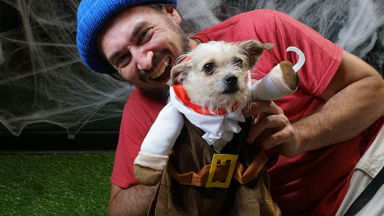 Resident and his small dog in a Captain Hook costume at the a Yappy Hour event.