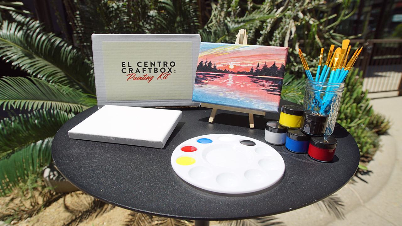 Painting kit laid out on an outdoor table for the CraftBox event.