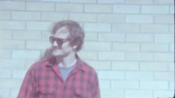 Ben standing in front of brick wall.